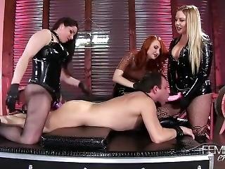 Three Latex Mistresses Fuck A Slave