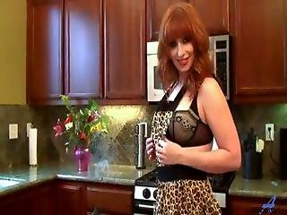 Gorgeous Redhead Cougar Goes From Cooking To Masturbating On The Kitchen Counter