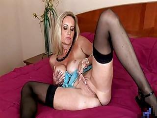 Sexy Mature Masturbates On Bed