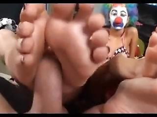 Hot Clown Double Footjob.