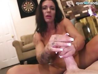 Milf Gives A Handjob To A Big Dick