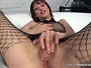 Redhead In A Fishnet Turns Cowgirl