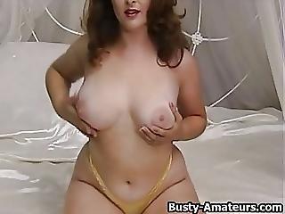 Busty Jonee Strips Showing Her Hairy Pussy