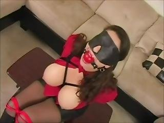 Ballgagged And Blindfolded Wearing Leather Gloves And Boots