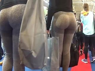 Two Candid Fit Asses In Grey Yoga Pants Walking