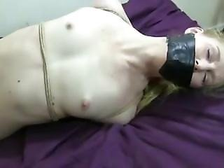 Blonde Self-gags Then Hogtied Nude On Bed
