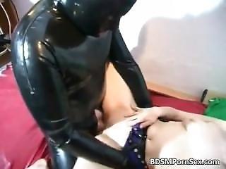 Brunette Slut Is In Latex And Gasmask