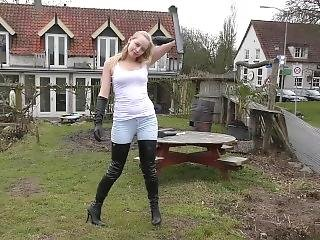 Super Cute German Blonde Wearing Crotch High Boots And Gloves