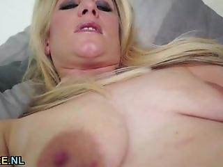 Blonde MILF with saggy tits masturbating