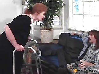 Aunt On Stilts Sucks Cock