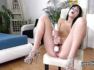 Beautiful Sweetie Is Pissing And Rubbing Shaven Pussy
