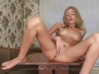 Cute Russian Skinny Blonde Plays On The Table