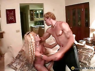 Bitch With A Member Between His Legs Kisses His Chest