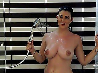 Breasty Dark Brown Model Eden Taking A Shower