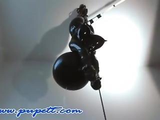 Suspended Upsidedown Rubber Bondage Doll