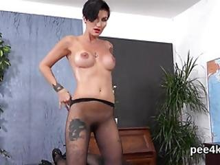 Stunning Chick Is Peeing And Rubbing Shaven Cunt