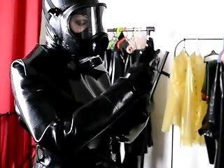 Dressing Into 3 Layers Of Latex Catsuit And Rubber Coat With Gasmask