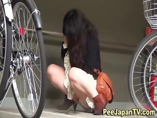 Asian Babe Caught Peeing