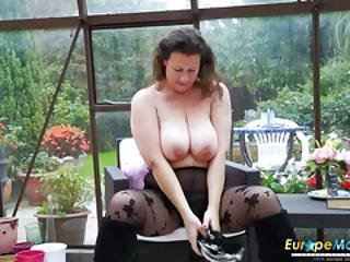Mature Lady Is Pleasing Herself Playing With Her Big Boobs