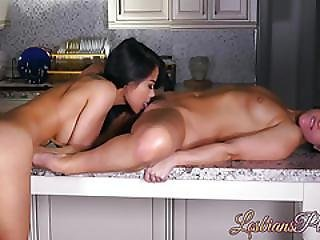Hot Asian And Brunette Babe Are Having Lesbian Sex In Kitchen