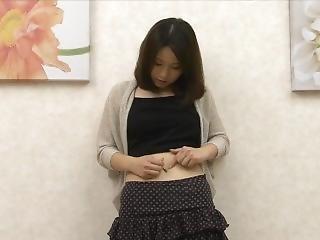 Japanese Girl Cleaning Her Navel 1