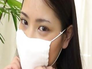 Busty Japanese Girl Tries On Masks