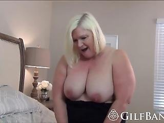 Busty Blonde Gilf Enjoys Giving A Titjob And A Blowjob To A Long Black Cock Afterwards She Gets Her Experienced Pussy Stretched In A Bedroom