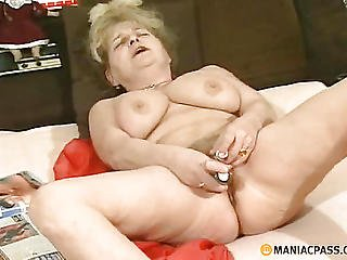 Woman In Her Pussy Shoves A Toy