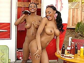Ebony Sisters With Big Tits Have Fun At A Camping Bbq
