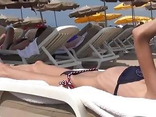 Super Skinny Girl Sunning At The Beach