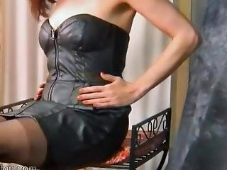 Kinky Brunette Milf Removes Her Leather Dress And Reveals Her Tits Thong And Sexy Nylons