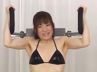 Cute Asian Girl With Natural Muscle Making Workout At Gym
