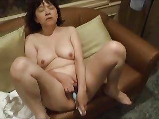 Horny Japanese Milf Kui Somya Toying On The Sofa 2