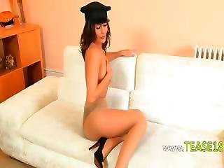 Policewoman Stripping On The White Couch