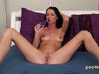 Charming Kitten Is Urinating And Masturbating Shaven Pussy