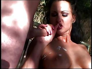 Brunette With Nice Tits Strokes A Cock In Each Hand