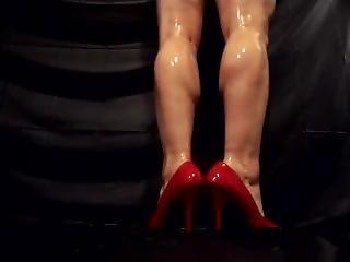 Oiled Muscular Calves In High Heels