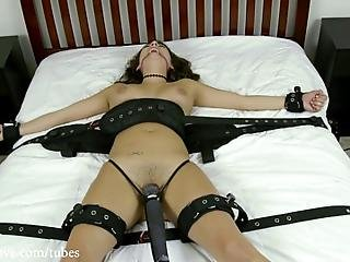 Charlotte Finds Herself Spread Eagle On A Bed Bound In Heavy Leather Cuffs With The Hitachi Wand Firmly Planted On Her Pussy