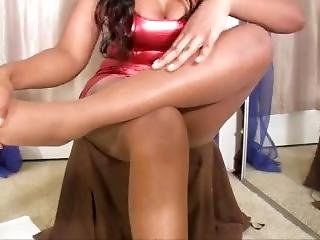 Ebony In Nude Pantyhose And Tight Red Skirt