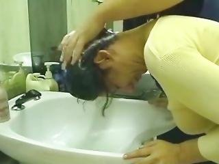 7 Female Washing Hair In Hairdresser