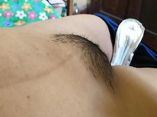 Playing With The Lips Of A Hairy Pussy