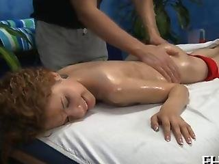Curly Redhead Gets Naked For An Oil Massage