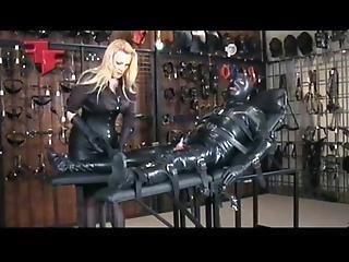 Mistress Puts Gimp In Heavy Enclosure Leather Bondage