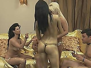 Muscled Guy Fucks Three Horny Ladies In Sexy Golden Outfits