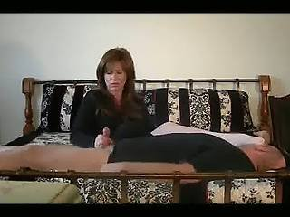 Mistress Got Her Hands On Man S Cock And Her Feet On His Face