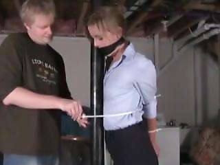 Pretty Lady Zip Tied To A Pole