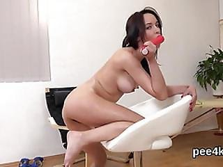 Attractive Nympho Is Peeing And Masturbating Smooth Cunt