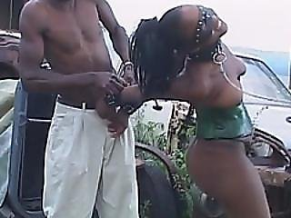 Sexy African Sista Enjoying A Submissive Double Blowjob