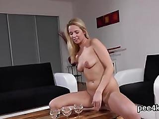 Stunning Nympho Is Peeing And Finger Fucking Shaven Slit