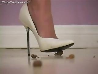 Snails Stamped On And Grinded Into The Floor By White High Heels